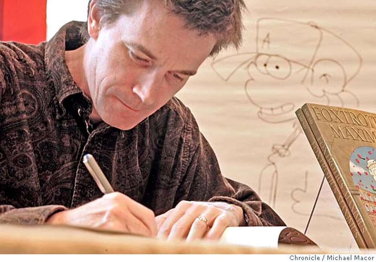 """amend_050_mac.jpg Amend signs books as his Comic character, """"Peter"""" looks over his shoulder. Bill Amend at the Borders Bookstore in Santana Row, San Jose to greet fans and sign books. Bill Amend is the creator of the FoxTrot comic that runs in the Chronicle and hundreds of other newspapers across the country. He grew up in Burlingame and many of the elements of the series about the Fox family were conceived when he lived in the Bay Area. 10/23/04 San Jose, CA Michael Macor / San Francisco Chronicle Mandatory Credit for Photographer and San Francisco Chronicle/ - Magazine Out"""