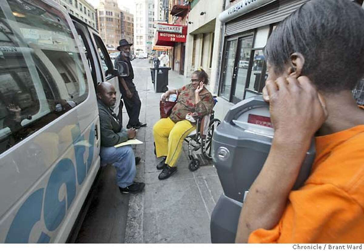 Outreach workers stop to help a woman on Sixth Street in San Francisco...outreach teams regularly patrol this area of the city known for homelessness and drug use. Here they stop to help a woman in a wheelchair named Lillian who is trying to get into a shelter. In 2004, the city of San Francisco started to implement the Care Not Cash program. One aspect of the program was to send outreach workers into the streets to contact the chronically homeless people and try to place them in hotel rooms. On Jones Street in the Tenderloin, several homeless people were helped inside, while others proved more difficult. 10/14/04 Brant Ward