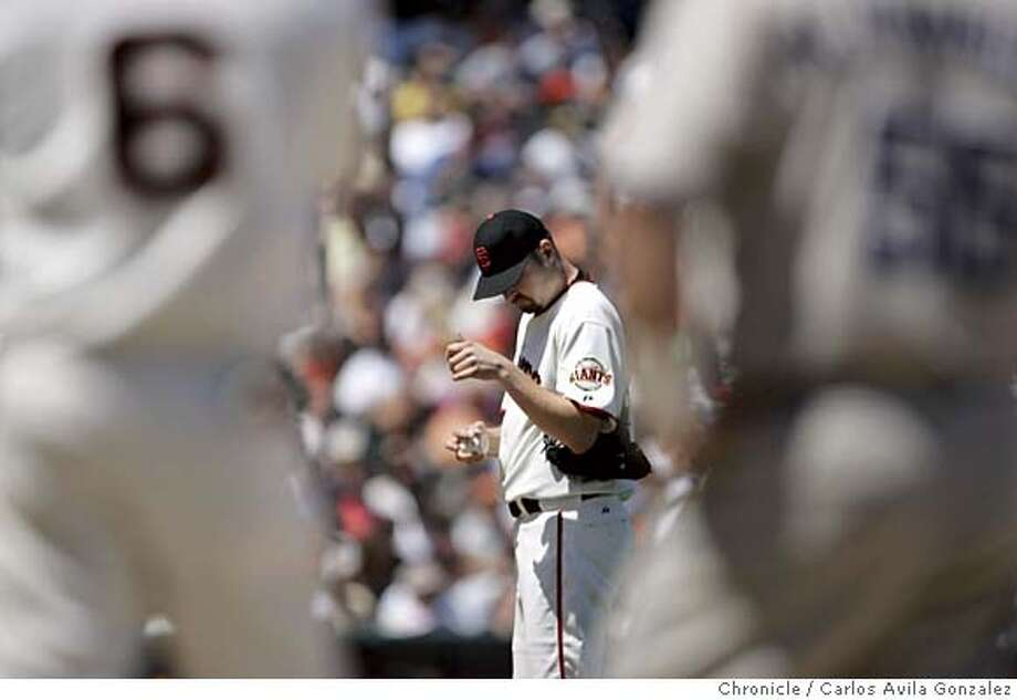 Giants starting pitcher, Jason Schmidt, collects himself after giving up an rbi single to Ramon Hernandez in the top of the fourth inning. The San Francisco Giants played the San Diego Padres at SBC Park in San Francisco, Ca., on Sunday, May 29, 2005. The Giants lost the game 9-6.  Photo by Carlos Avila Gonzalez / The San Francisco Chronicle  Photo taken on 5/29/05, in San Francisco,CA. Photo: Carlos Avila Gonzalez