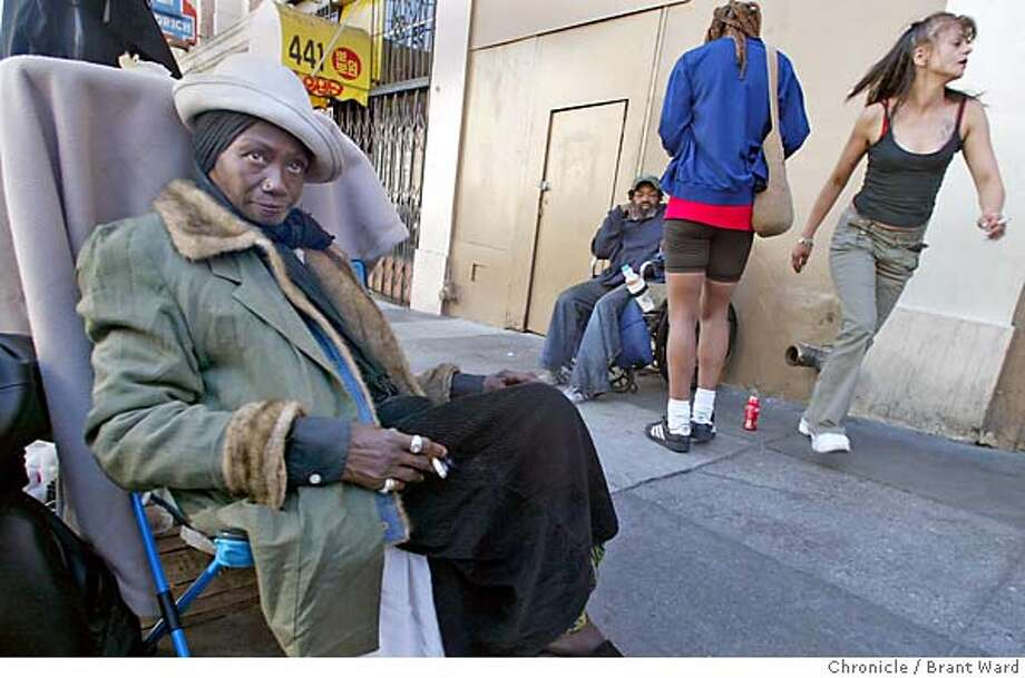 Billie Washington holds court at her most familiar home on Jones Street in the Tenderloin...she sits in a chair smoking while the commotion of the city goes on around her.  Brant Ward 9/1/04 Photo: Brant Ward