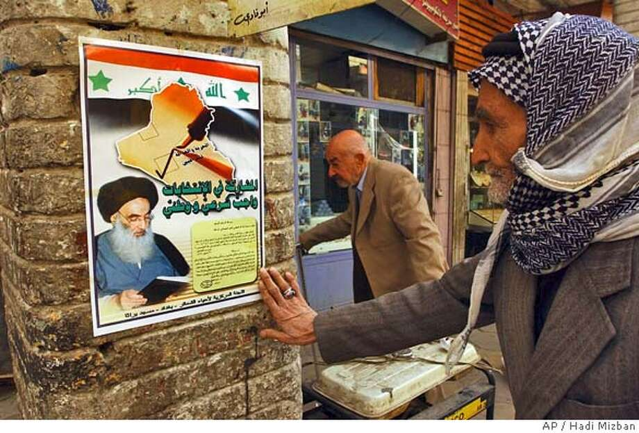 Iraqi reads a poster with fatwa, or religious ruling, issued by Shiite cleric Grand Ayatollah Ali al-Sistani, on the picture, to encourage people to vote in Iraq's upcoming elections in Baghdad Tuesday Nov. 23, 2004. Iraq's Election Commission announced on Sunday that the poll to elect a transitional parliament will be held on January 30 2005. (AP Photo/Hadi Mizban) Insight#Insight#Chronicle#12/05/2004##2star##0422481659 Photo: HADI MIZBAN