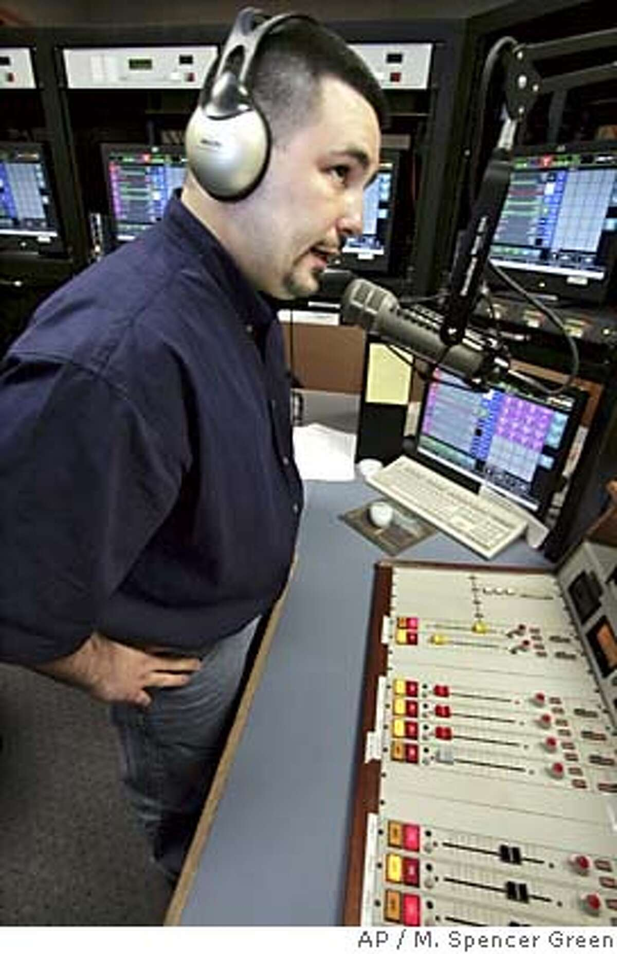 Matt DuBiel, program director and afternoon personality for radio station Nine FM, does a live piece on the air Friday May 13, 2005 in Chicago. The station has begun a