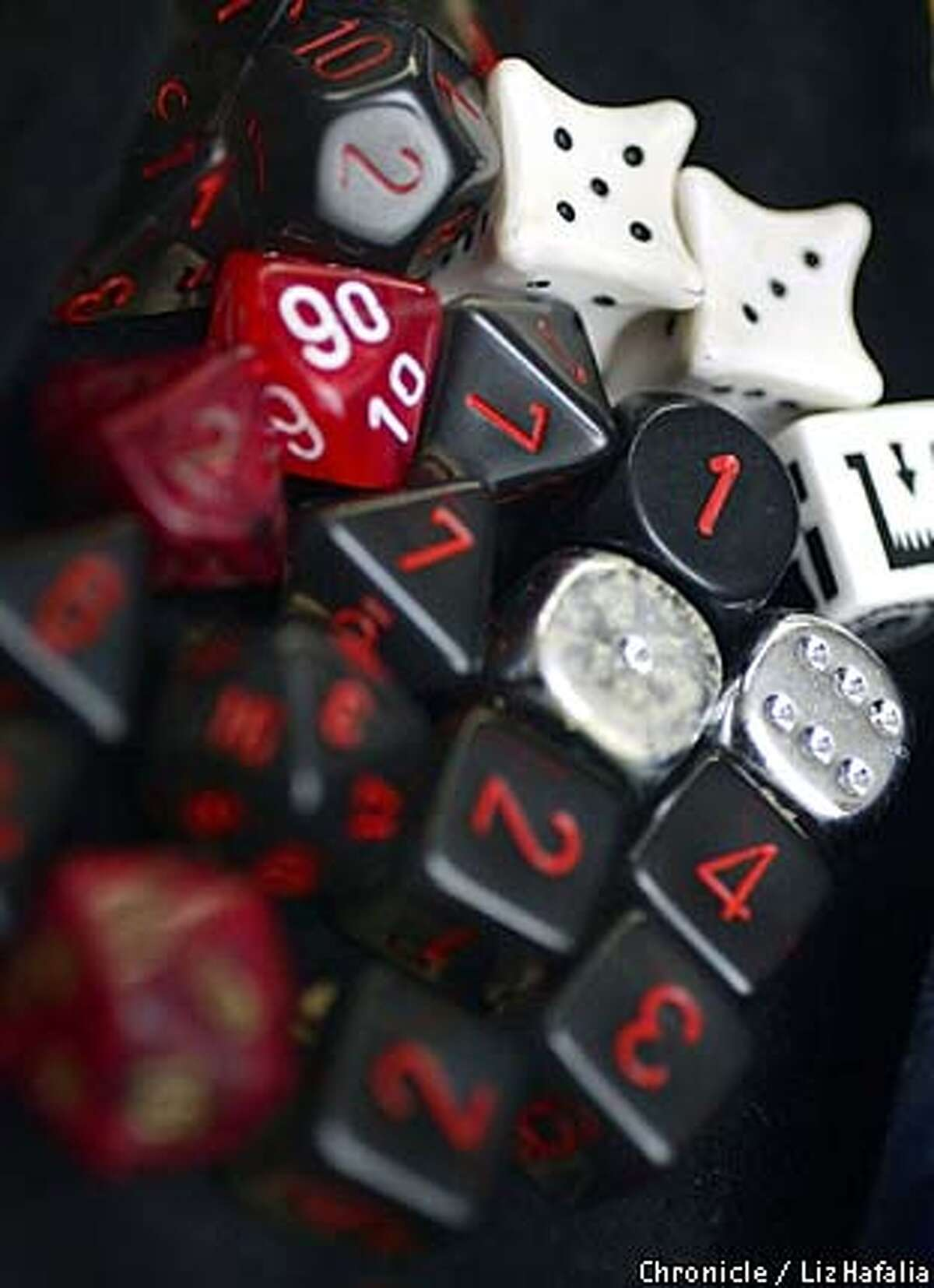 Dice are used during the game of Abantney to determine success or failure. (PHOTOGRAPHED BY LIZ HAFALIA/THE SAN FRANCISCO CHRONICLE)