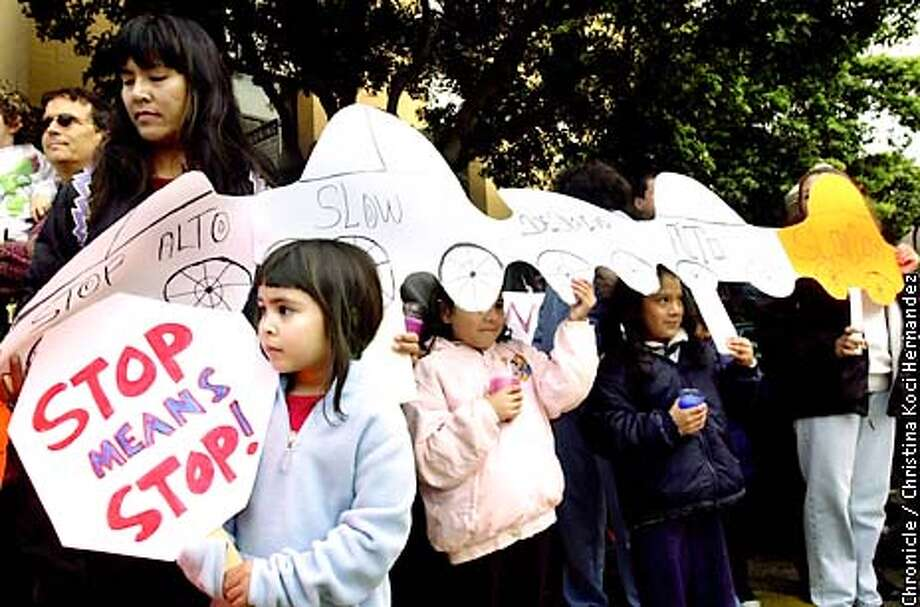 CHRISTINA KOCI HERNANDEZ/CHRONICLE  (With stop sign on far left) Liara Grant,6, student at Buena Vista, readies to march in honor of Elizabeth. Memorial School Safety March, to honor Elizabeth Dominguez, a student at Buena Vista Elementary School, in SF, who was fatally struck by a car on Feb.11, after school at Potrero at 24th. Photo: CHRISTINA KOCI HERNANDEZ
