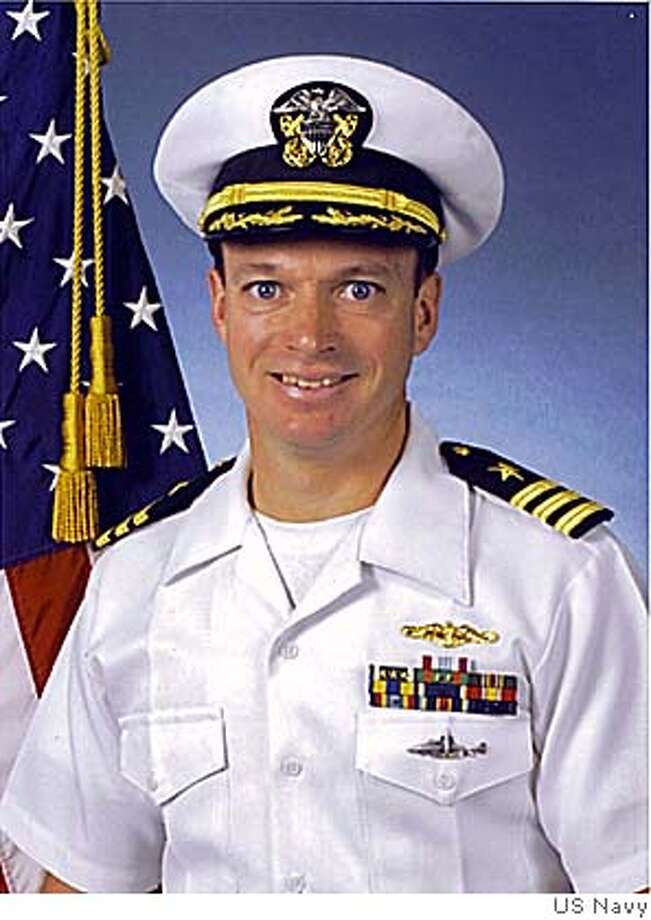 This photo released by the US Navy Sat. Feb. 12, 2005 shows an undated official US Navy portrait of Cmdr. Kevin Mooney. Mooney was relieved of command of the USS San Francisco and reprimanded following disciplinary proceedings in Yokosuka naval base just south of Tokyo, the U.S. Seventh Fleet said in a statement on its Web site Saturday Feb. 12, 2005. An investigation found that critical safety procedures were overlooked on the nuclear submarine, which ran aground last month killing one crew member.(AP Photo/US Navy) PHOTO RELEASED BY THE U.S. NAVY PHOTO