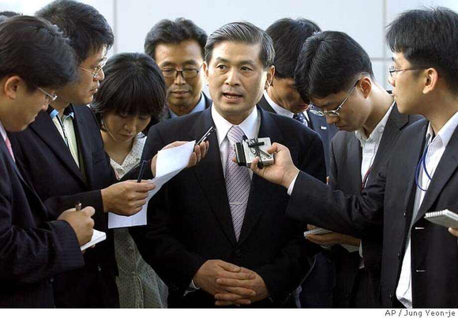 Seoul National University professor Hwang Woo-suk, center, is surrounded by journalists upon his arrival at the Incheon Airport, west of Seoul, Friday, May 20, 2005. South Korean scientists have dramatically sped up the creation of human embryonic stem cells, growing 11 new batches that for the first time were a genetic match for injured or sick patients. (AP Photo/Jung Yeon-je, Pool) POOL Photo: JUNG YEON-JE