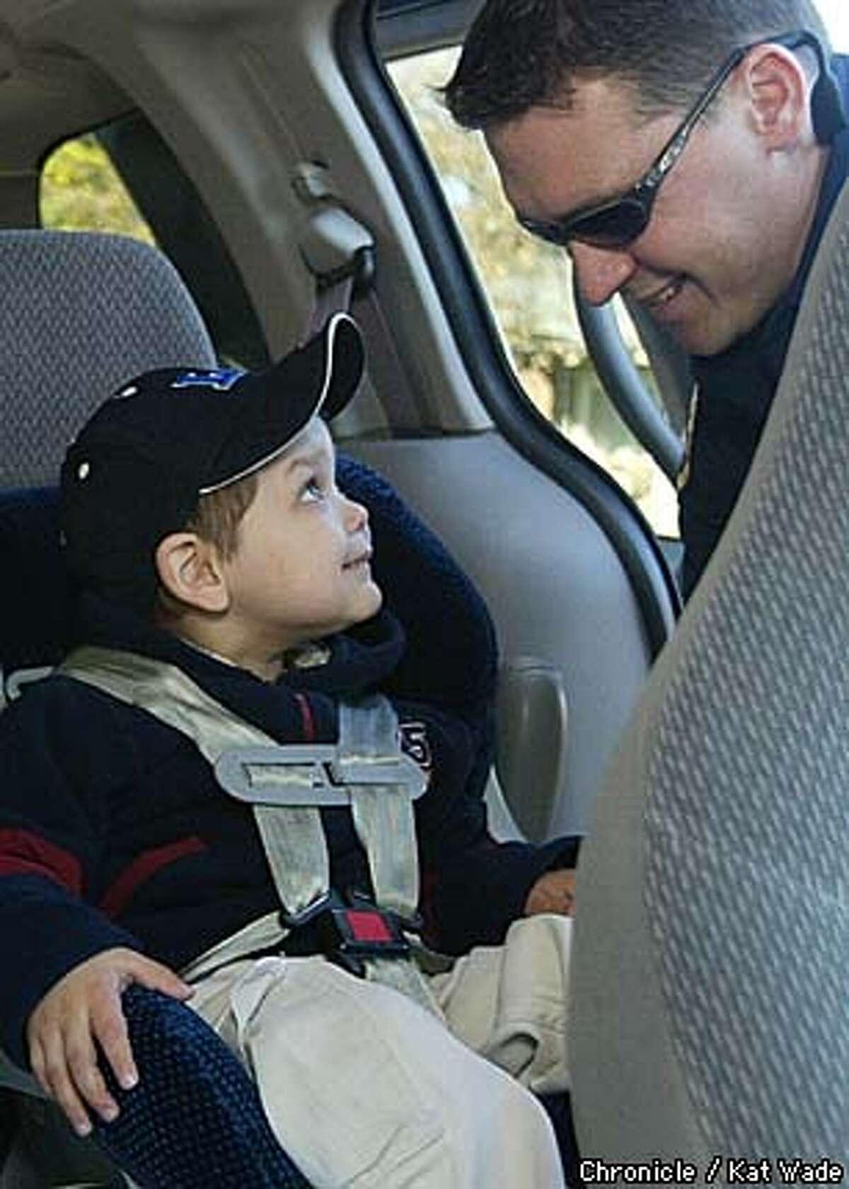 Matt Brown, a paramedic witht Santa Clara Fire Department station #1 secures little cancer patient Adalberto