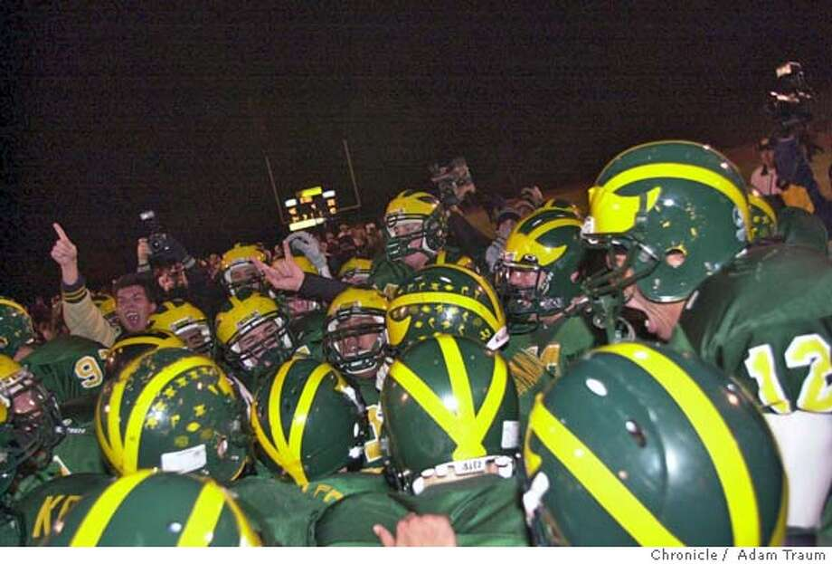 The San Ramon Valley Wolves celebrate their win over Las Lomas Knights Saturday night after winning a convincing 20-46. Photo by Adam Traum