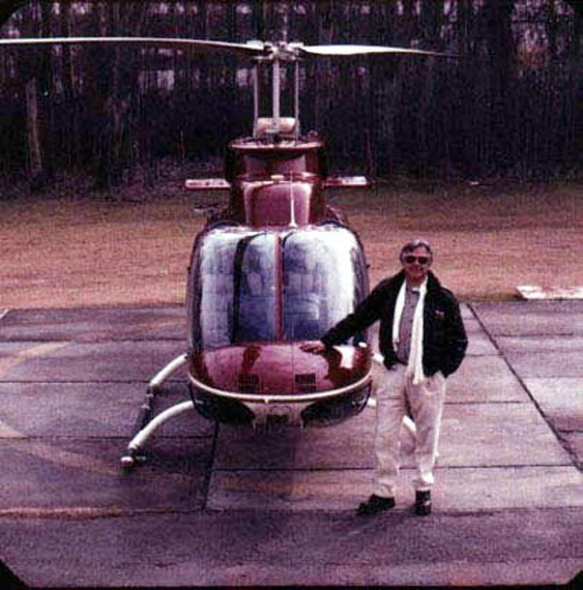 CARDOEN0302Z-C-04FEB03-MG-HO --- Carlos Cardoen stands next to one of his company helicopters (HANDOUT PHOTO)