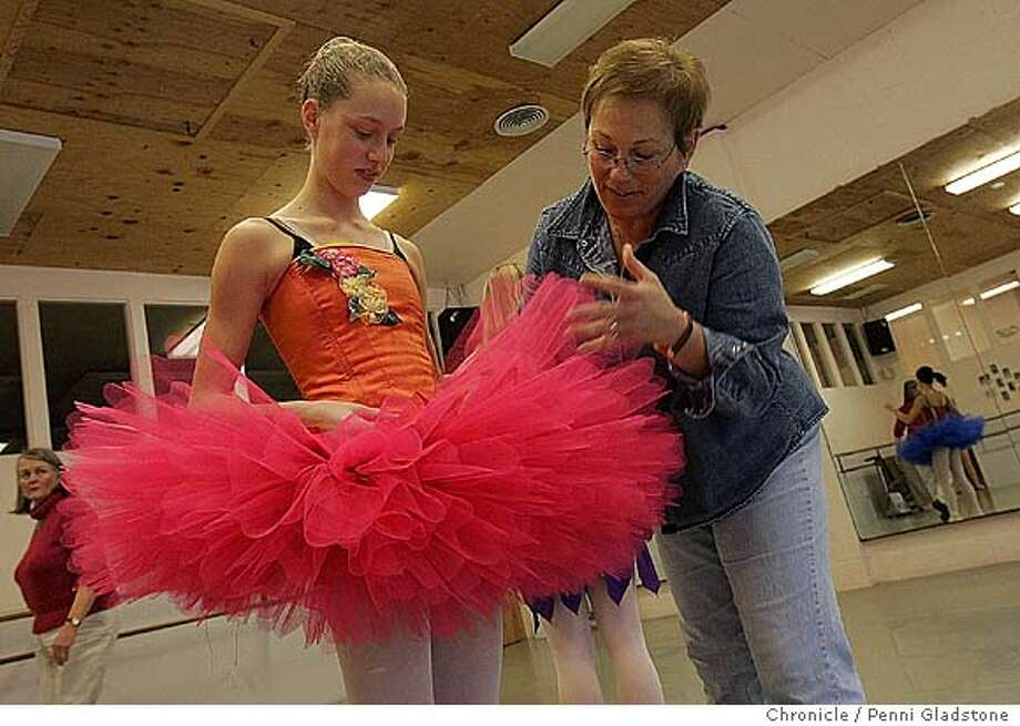 "Laura Quinn age 13 put on her tutu for the first time and gets a little fluff up by gina.  Gina Gray, Costume Mistress for The Stapleton Ballet production of ""The Nutcracker."" After attending a four-day tutu workshop in Los Angeles earlier this year on mastering construction of the tutu, and after nearly 500 hours of work, Gray and her team of five volunteers has made 30 tutus specifically designed for members of the Stapleton company. They are finishing up the tutus and fitting them Event on 11/8/04 in SAN ANSELMO.  PENNI GLADSTONE / The Chronicle Photo: PENNI GLADSTONE"