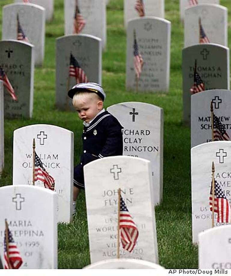 Kennard MacVaugh of Goodview, Va., 19-months, walks among the headstone markers at Arlington National Cemetery in Arlington, Va., Friday, May 25, 2001. MacVaugh and his family paid a pre-Memorial Day visit to the gravesite of his grandfather Kennard MacVaugh. (AP Photo/Doug Mills) DIGITAL IMAGE Photo: DOUG MILLS