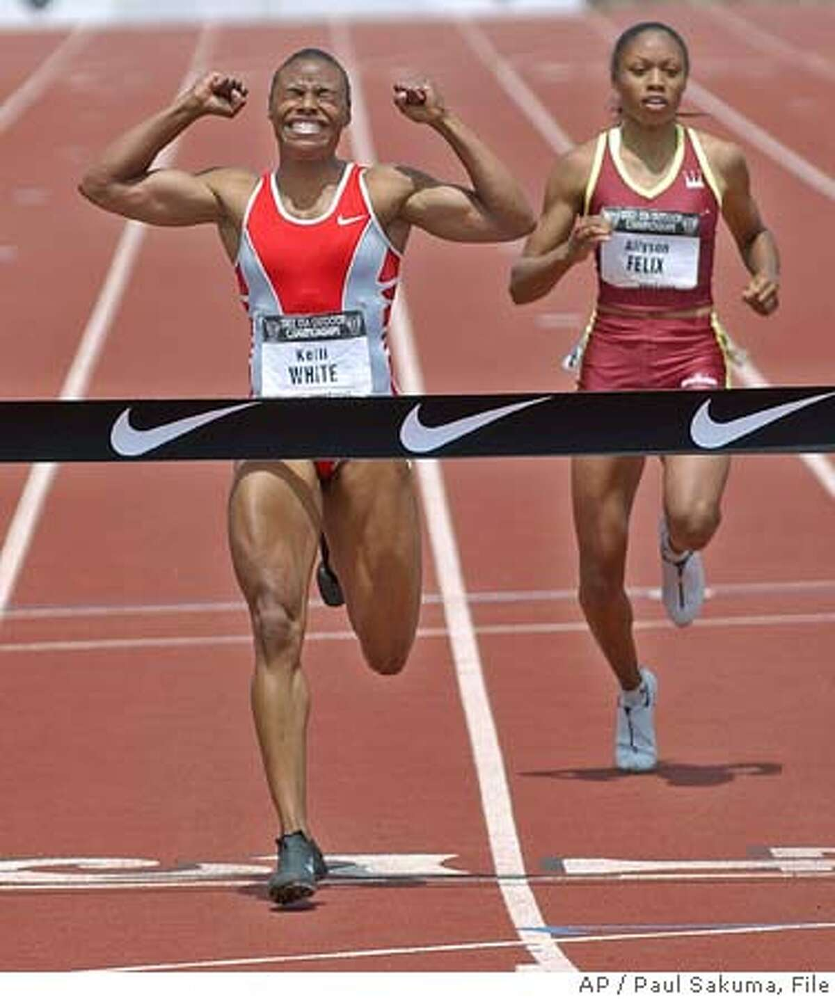 Kelli White, left, gestures after winning in the finals of the 200 meters in 22.21 seconds in the U.S. track and field championships, Sunday, June 22, 2003, in Stanford, Calif. At right is third-place finisher Allyson Felix, with a time of 22.59 seconds. By finishing third Felix, who graduated from high school Friday, made the U.S. team for the world championships. (AP Photo/Paul Sakuma) ALSO RAN 06/23/03, 05/20/04 Kelli White won the 200 at the U.S. championships at Stanford last June, but it doesnt count. Kelli White won the 200 at the U.S. championships at Stanford last June, but it doesnt count. ProductNameChronicle cat Metro#MainNews#Chronicle#12/3/2004#ALL#5star##0421263779