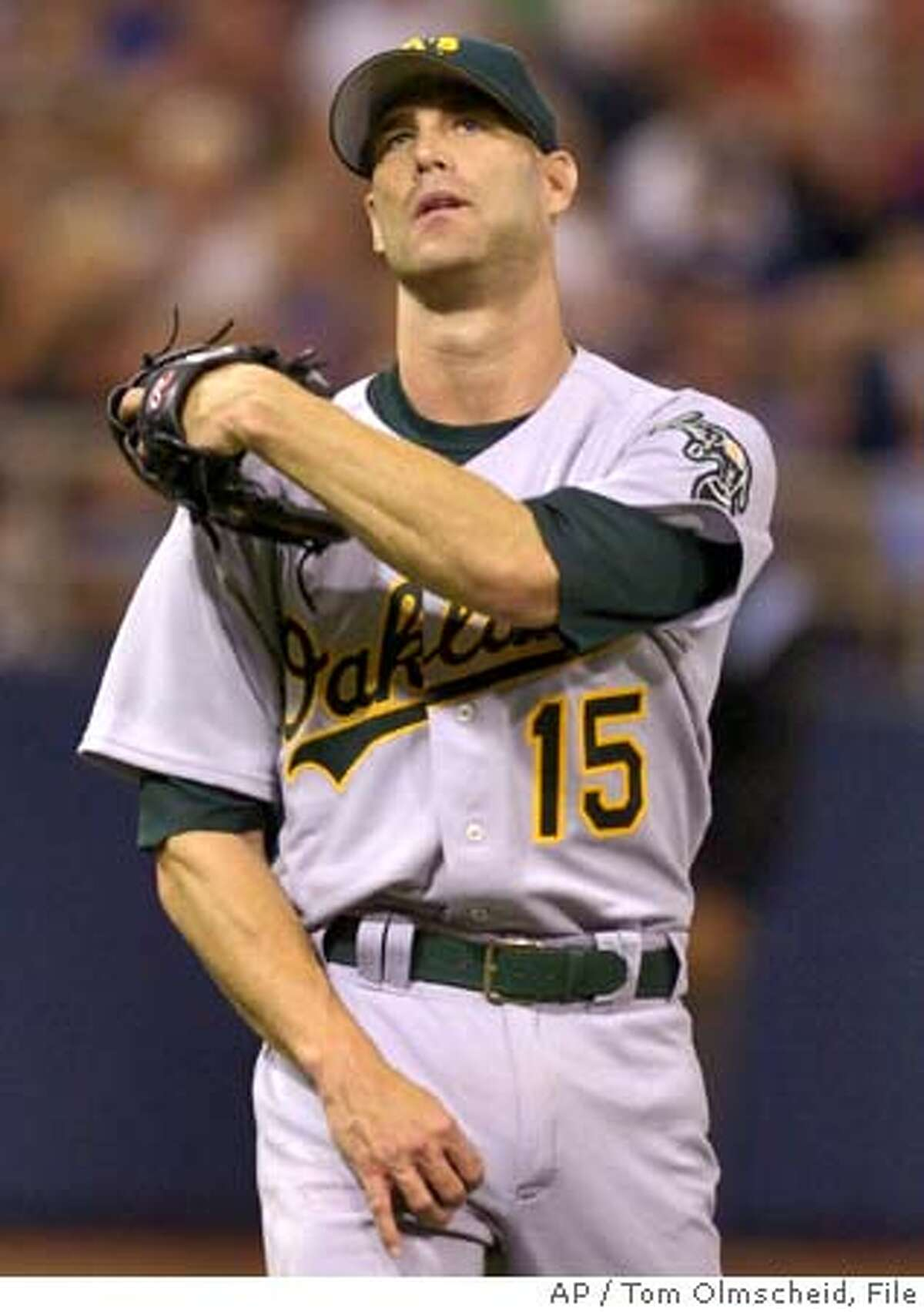 Oakland Athletics' starting pitcher Tim Hudson reacts after giving up a single to Minnesota Twins' Jose Offerman that allowed the third run of the sixth inning to score, Saturday, Aug. 7, 2004 in Minneapolis. This was Hudson's first start since coming off the disabled list. (AP Photo/Tom Olmscheid) Ran on: 08-08-2004 Tim Hudson, in his first start for the As since coming off the disabled list, allowed four runs, three of them in the sixth inning. Ran on: 08-08-2004 Tim Hudson, in his first start for the As since coming off the disabled list, allowed four runs, three of them in the sixth inning. Sports#Sports#Chronicle#12/3/2004#ALL#5star##0422240964