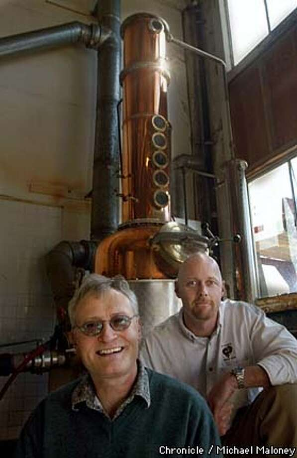 SPIRITS227-C-19FEB03-FD-MJM  Jorg Ruph (left) and Lance Winters of Saint George Spirits of Alameda. They make fine brandies and other liquor in German hand crafted Holstein stills (in bacground).  CHRONICLE PHOTO BY MICHAEL MALONEY Photo: MICHAEL MALONEY