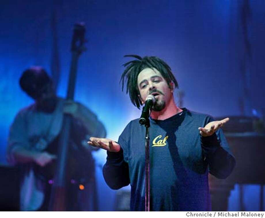 "Counting CrowsEx-UC Davis and UC Berkeley student Adam Duritz, a vocalist and pianist, and guitarist David Bryson formed Counting Crows first as a duo in 1991, a couple years after they met. The pair of musicians, who took their name from a movie called ""One for Sorrow"" starring Duritz's friend Mary-Louise Parker, originally played around the Bay Area in acoustic sets. Eventually, they began to incorporate more musicians, including guitarist David Immerglück (who also played with Camper Van Beethoven for a time), keyboardist Charlie Gillingham on keyboards, drummer Steve Bowman and bassist Matt Malley. The band became well-known around town with a full lineup and was signed to Geffen Records in 1993. They recorded their debut record, ""August and Everything After,"" but before it was released, they performed at a Rock and Roll Hall of Fame Induction Ceremony in place of the absent Van Morrison (they played a Van Morrison cover). When the album came out, it was a huge success, landing and staying on the pop charts for 93 weeks at the beginning of 1994. The new name recognition even earned them the coveted privilege of opening for the Rolling Stones on tour.Pictured: Adam Duritz of the Counting Crows at a show at the Warfield on December 16, 2003. Photo: Michael Maloney"
