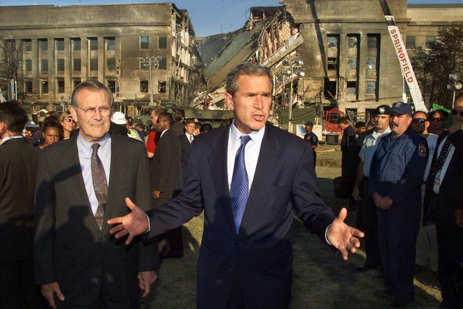 President Bush examines the devastation at the Pentagon in Washington, Wednesday, Sept. 12, 2001. Accompanied by Secretary of Defense Donald Rumsfeld, left, Bush thanked rescue workers for their efforts as he stood in front of the damage created by the highjacked airliner that slammed into the building on Tuesday. (AP Photo/Pablo Martinez Monsivais) Photo: PABLO MARTINEZ MONSIVAIS / AP2001