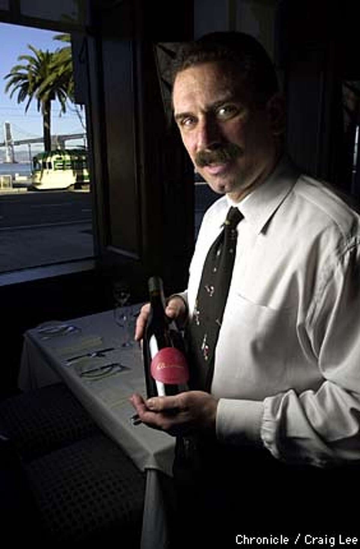 Sommelier John Lancaster of Boulevard restaurant with it's view of the Bay Bridge along the Embarcadero. Photo by Craig Lee/San Francisco Chronicle