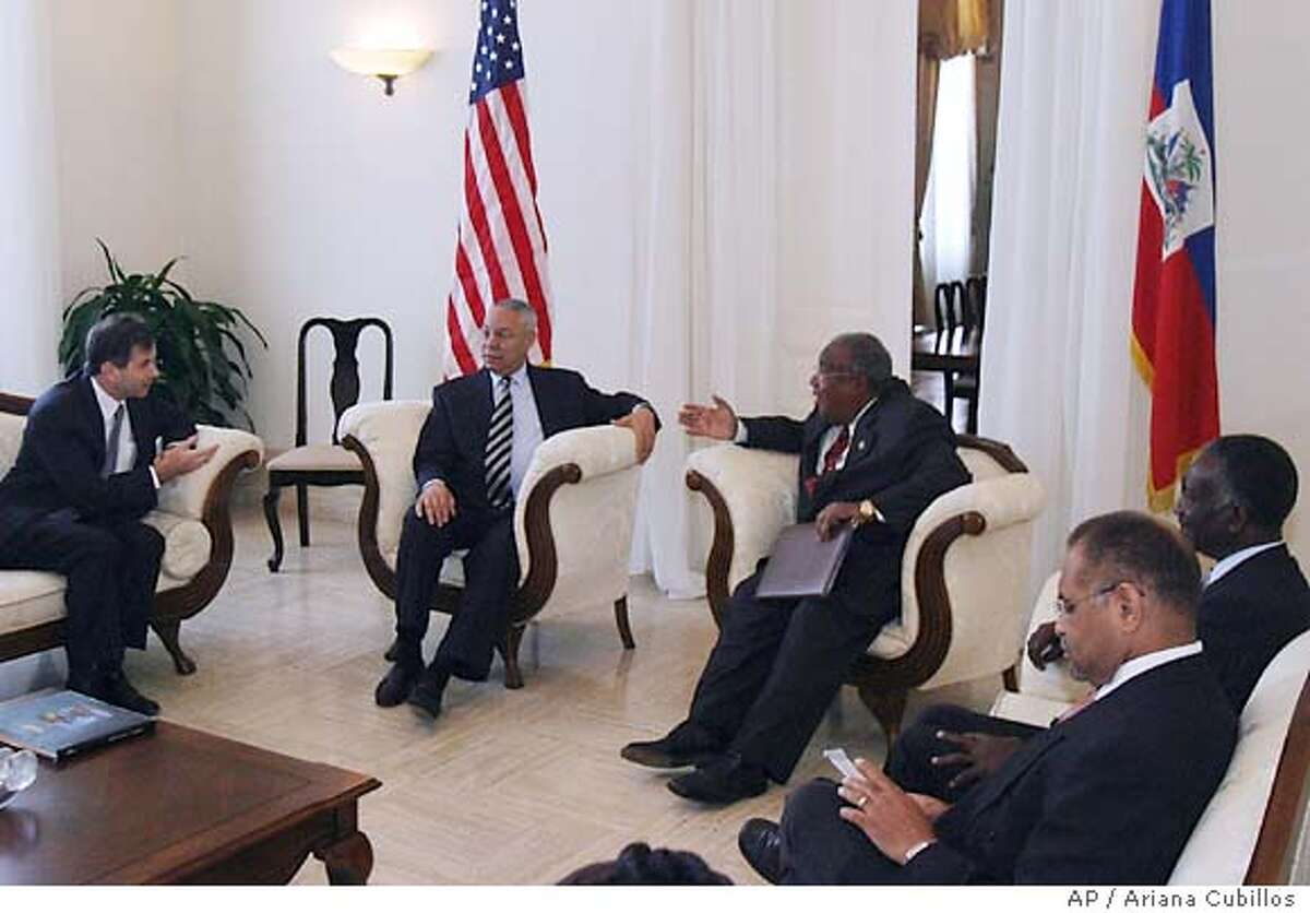 From left to right,U.S. Ambassador James B. Foley, Secretary of State Colin Powell, Interim Prime Minister Gerard Latortue, Haitian Economy Minister Henri Bazin and Haitian Minister of Justice Bernard Gousse during a meeting at the Presidential Palace in Port-au-Prince, , Wednesday, Dec. 1, 2004. (AP Photo/Ariana Cubillos)