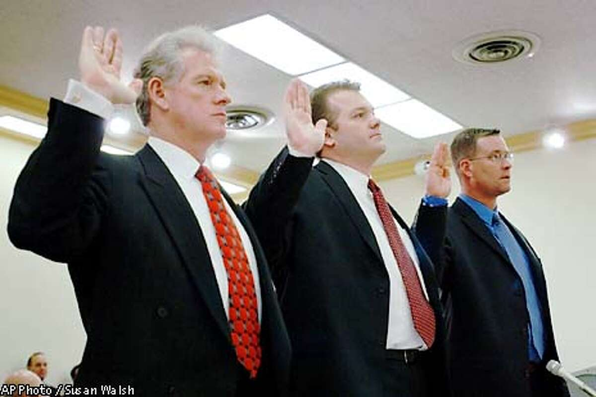 ** RETRANSMITTED TO CORRECT SECOND SUBJECT'S NAME TO STEVE DORAN, INSTEAD OF STEVE DUNN ** Glenn Walp, left, Steve Doran, center, and Jaret McDonald are sworn in before testifying before a congressional subcommittee on Capitol Hill, Wednesday, Feb. 26, 2003 investigating the alleged loss of millions of dollars in lab equipment and dubious credit-card expenses at the Los Alamos National Laboratory in New Mexico. Walp and Doran are both consultants at the University of California. McDonald, whose identity had been withheld, is a lab facilities manager who told superiors in 2001 about allegations that the two employees had bought thousands of dollars in merchandise for their private use. (AP Photo/Susan Walsh)