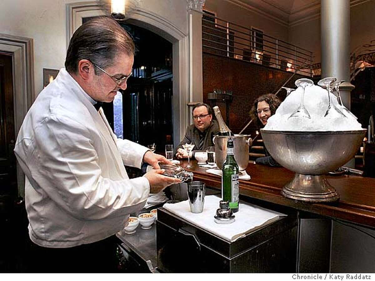 ENTERTAIN02_rad.jpg SHOWN: Bartender Bruce Minkiewicz carefully pours Damrak gin into a martini shaker. His customers for this treat are Patrick Ryan, a lawyer with Thelen Reid & Priest LLP, and Michelle Arney, a lawyer with The Sharper Image. The famous silver bowl filled with crushed ice and martini glasses awaits use on the bar. Story about the martini, its enduring lure and classy image. We go to Bix, the restaurant and bar on Gold St. in San Francisco. Katy Raddatz / The Chronicle