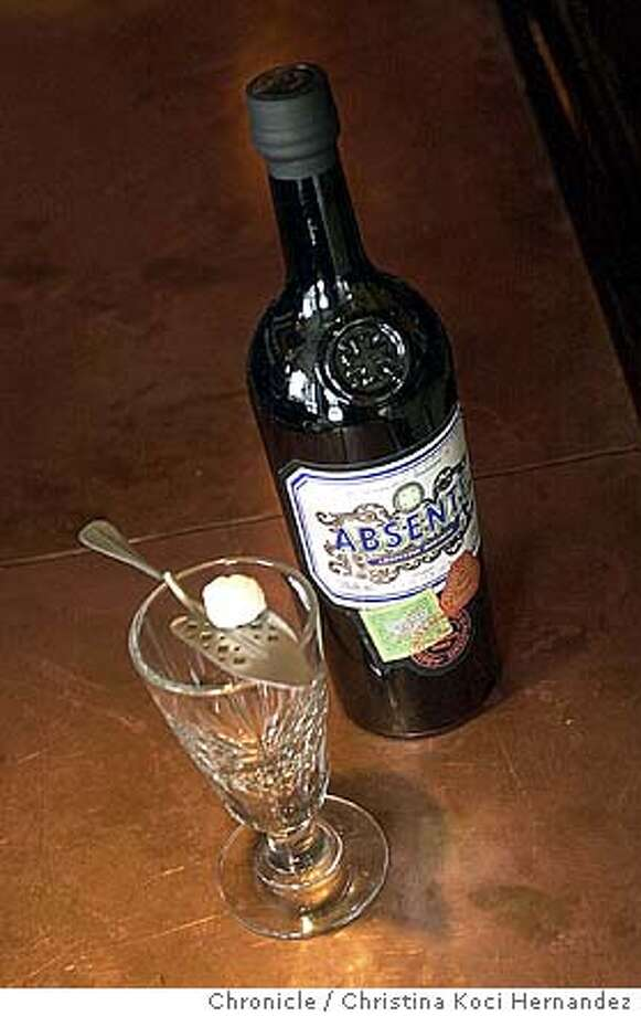 spirits13_110703_kocihernandez For a Spirts column on absinthe liqueur, need shots of absinthe artifacts that owners of the Absinthe restaurant are making available to us. Absinthe is illegal to buy in the U.S., though people sneak it here, so please don't shoot an actual bottle if one is made available to you.  CHRISTINA KOCI HERNANDEZ / The Chronicle Photo: CHRISTINA KOCI HERNANDEZ