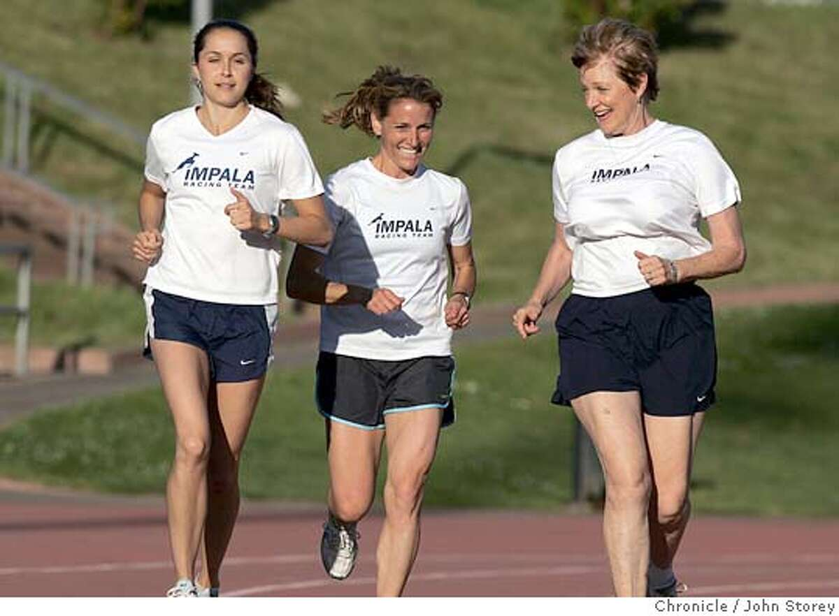 Runners_jrs_0176.jpg Story about the all women Impala running team, that trains at Kezar stadium. Left to Right: Caroline Annis, Cheryl Shwe, and Sue Johnston run on the track at Kezar. John Storey San Francisco Event on 5/24/05 MANDATORY CREDIT FOR PHOTOG AND SF CHRONICLE/ -MAGS OUT