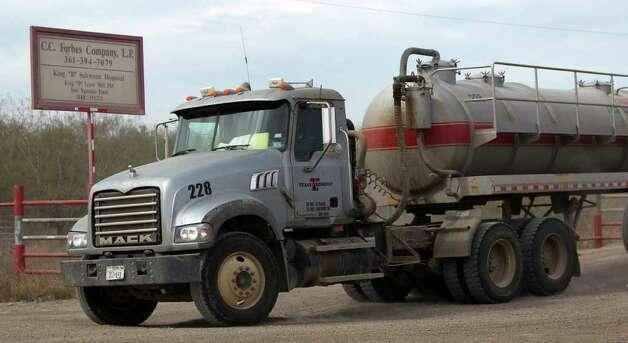 A Tx Energy Services truck leaves a site near San Ygnacio, Texas where salt water is disposed of. Plans by the company to begin disposing of oil field waste there has people in the nearby town of San Ygnacio upset. Photo: JOHN DAVENPORT, SAN ANTONIO EXPRESS-NEWS / SAN ANTONIO EXPRESS-NEWS (Photo can be sold to the public)