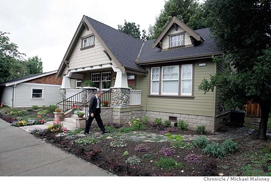 Emile Oxsen walks outside his bungalow-style home featured in a 1921 Sears catalog. Emile Oxsen of Pleasanton, who has made a living selling real estate for the past 30 years, is not a man enamoured of modern architecture. So when it came time to build a home for himself, he and his wife, Marjorie, chose a design for a relatively small, (1,200 square-foot) bungalow-style home featured in a 1921 Sears catalog. Photo by Michael Maloney / San Francisco Chronicle Photo: Michael Maloney