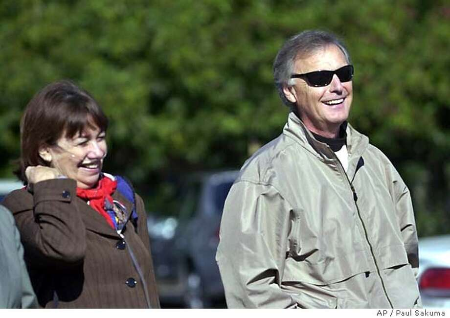 Lee and Jackie Peterson, parents of Scott Peterson, take a lunch break outside of a Redwood City, Calif., courthouse, Wednesday, Dec. 1, 2004, during the penalty phase of the trial. Lee Peterson testified earlier in the morning. Scott Peterson is the Modesto, Calif., man who could be sentenced to death for the murder of his wife, . (AP Photo/Paul Sakuma) Photo: PAUL SAKUMA