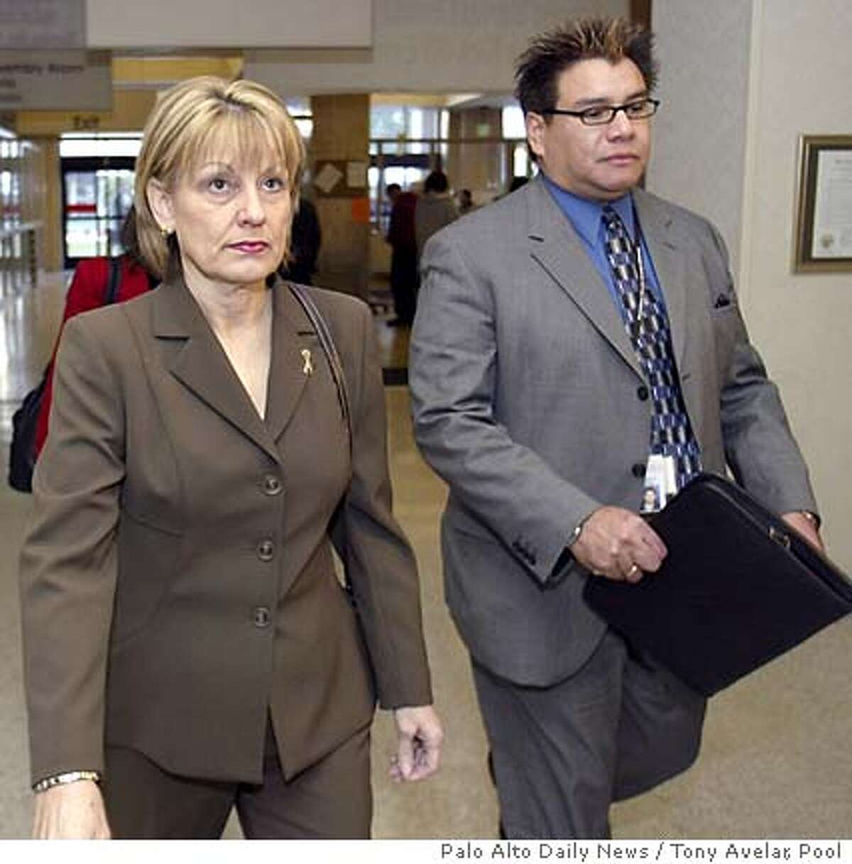 Sharon Rocha, mother of , and Alex Loya of Stanislaus County Victim's Witness arrive for the afternoon penalty phase in the Scott Peterson trial at a Redwood City, Calif., courthouse, Wednesday, Dec. 1, 2004. Peterson was convicted on one count of first-degree murder in the death of his wife, , and one count of second-degree murder for the killing of her fetus. (AP Photo/Tony Avelar, pool)