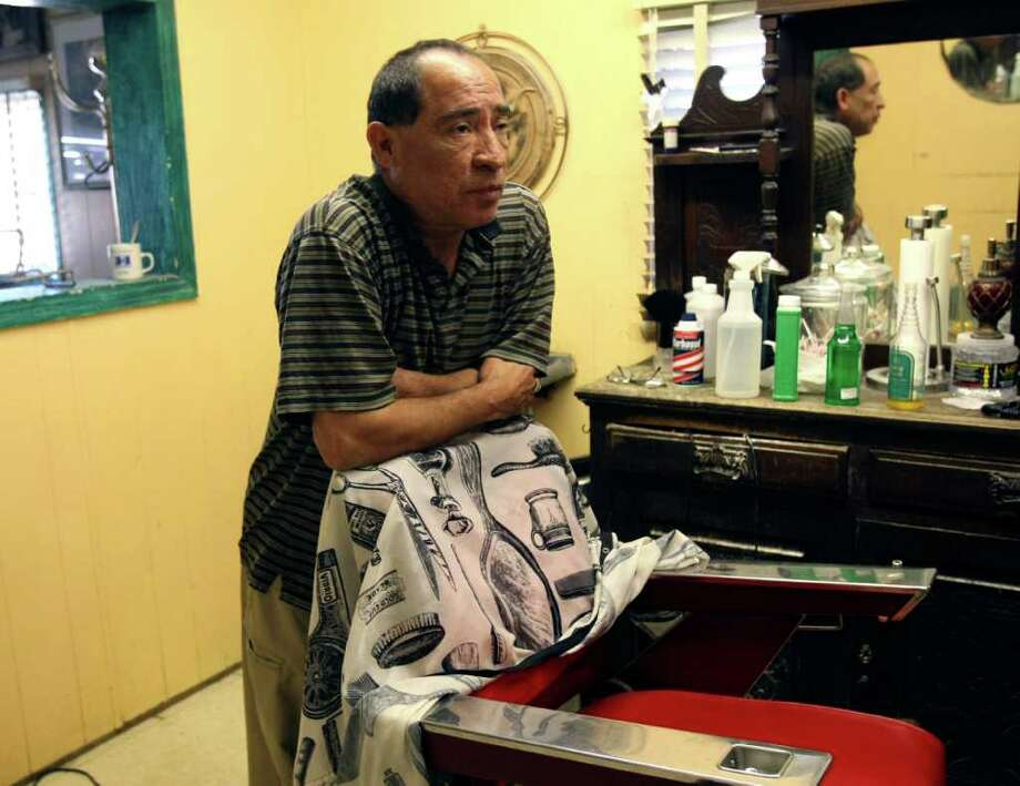 """Arturo Chavarria was born and raised in Three Rivers and owns a barber shop on the city's north side.  Chavarria, who was born the year of the Longoria incident,  said he doesn't remember the conflict. He said the incident is """"ancient history"""" to the current generation. Photo: HELEN L. MONTOYA, San Antonio Express-News / SAN ANTONIO EXPRESS-NEWS"""