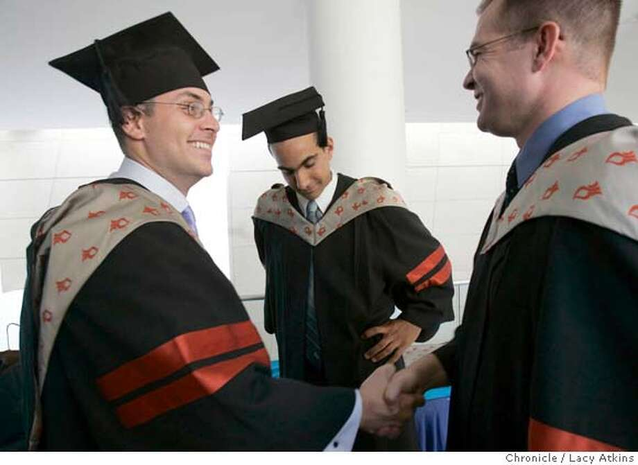 Jubran Dakwar, stands in the middle as (left to right) Joseph V. Sakran and Orie Browne shake hands as the class dresses for graduation, May 24, 2005, of the Ben Gurion University Medical School, in Be'ersheva Israel. Jubran Dakwar, a Palestinian, from San Jose, who left Israel at the age of 3 and now gratulates from Ben-Gurion University , Medical School for International Health, in Be'er Sheva, in the West Bank, May 24, 2005, in Irsael Photographer Lacy Atkins Jubran Dakwar, a Palestinian, from San Jose, who left Israel at the age of 3 and now gratulates from Ben-Gurion University , Medical School for International Health, in Be'er Sheva, in the West Bank, May 24, 2005, in Irsael Photographer Lacy Atkins Photo: LACY ATKINS