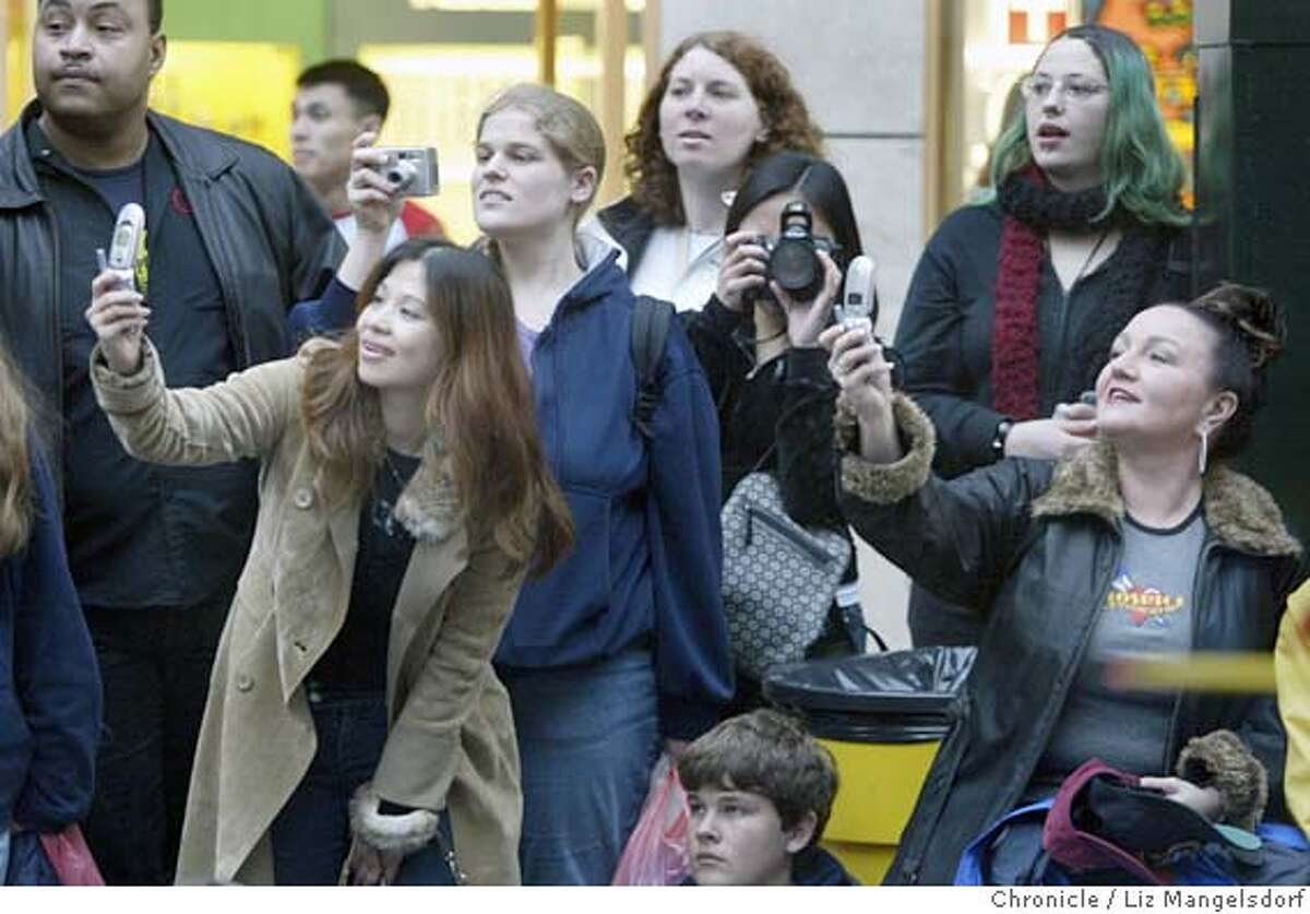 parade262_LM.JPG Spectators take photos of the parade on market street, using cell phones and regular cameras. The San Francisco Chinese New Year Parade goes down Market st. Photo by Liz Mangelsdorf / The San Francisco Chronicle Photo taken on 2/19/05, in San Francisco, CA. MANDATORY CREDIT FOR PHOTOG AND SF CHRONICLE/ -MAGS OUT
