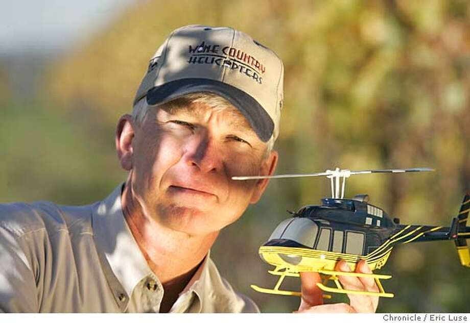 chopper_018_el.jpg  Owner wayne lackey: Wine Country Helicopter. Fly people through the wine country. He's holding a model of one of his helicopters, a 4 passenger Bell Jet Ranger.  Event on 11/23/04 in Napa. Eric Luse / The Chronicle MANDATORY CREDIT FOR PHOTOG AND SF CHRONICLE/ -MAGS OUT Metro#Metro#Chronicle#11/30/2004#ALL#5star##0422481119 Photo: Eric Luse