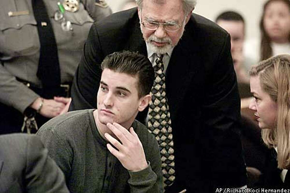 ** FILE **Jaron Chase Nabors is surrounded by his lawyers during a preliminary hearing in a courtroom in Fremont, Calif., Jan. 29, 2003. Nabors pleaded guilty to voluntary manslaughter Monday, Feb. 24, 2003, and agreed to testify against his friends. He will get 11 years in prison under the agreement reached with prosecutors for his role in the death of transgender teen Eddie Gwen Araujo. (AP Photo/San Jose Mercury News, Richard Koci Hernandez, File)