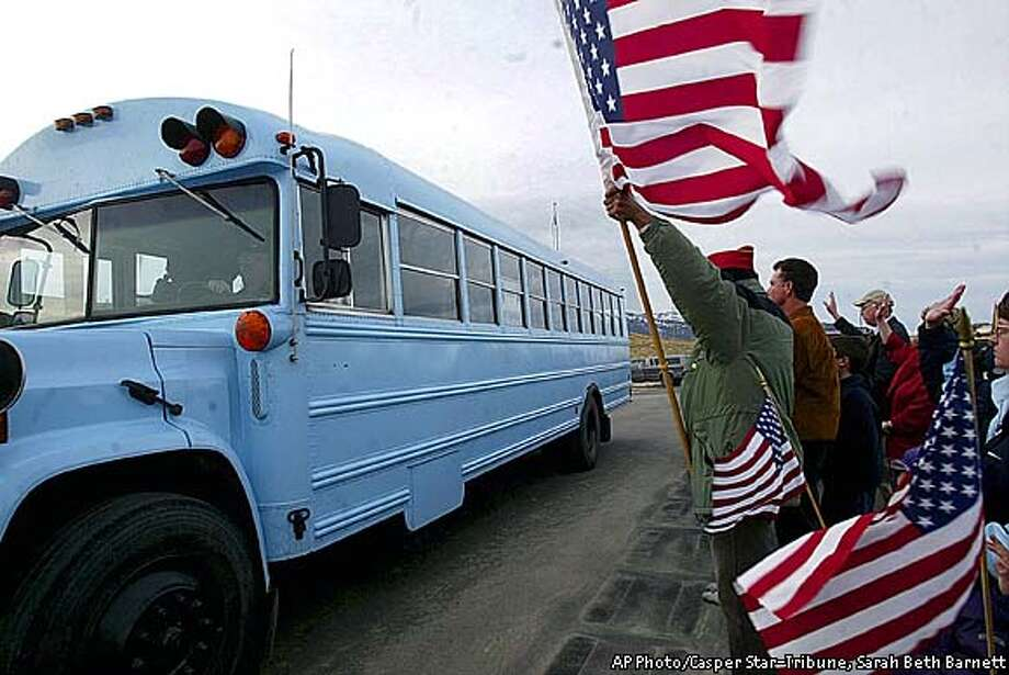 Friends and family wave goodbye to the member of the 4th Infantry Division as they depart from the Wyoming National Guard Armory in Casper, Wyo., Monday, Jan. 27, 2003. (AP Photo/Casper Star-Tribune, Sarah Beth Barnett) Photo: SARAH BETH BARNETT