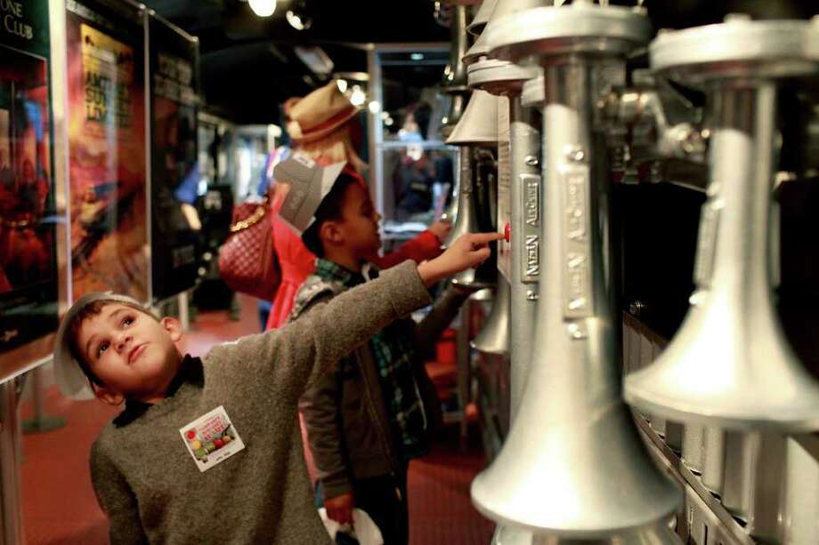 Tommy Hernandez, 6, left, presses a button to hear the different horn sounds with his brother, Noey Hernandez, 8, on the Amtrak 40th Anniversary Exhibit Train at Sunset Station on Saturday, Jan. 21. 2012. The exhibit will be open Sunday, Jan. 22, from 10 am to 4 pm. Lisa Krantz/San Antonio Express-News Photo: Lisa Krantz, San Antonio Express-News / @2012 SAN ANTONIO EXPRESS-NEWS