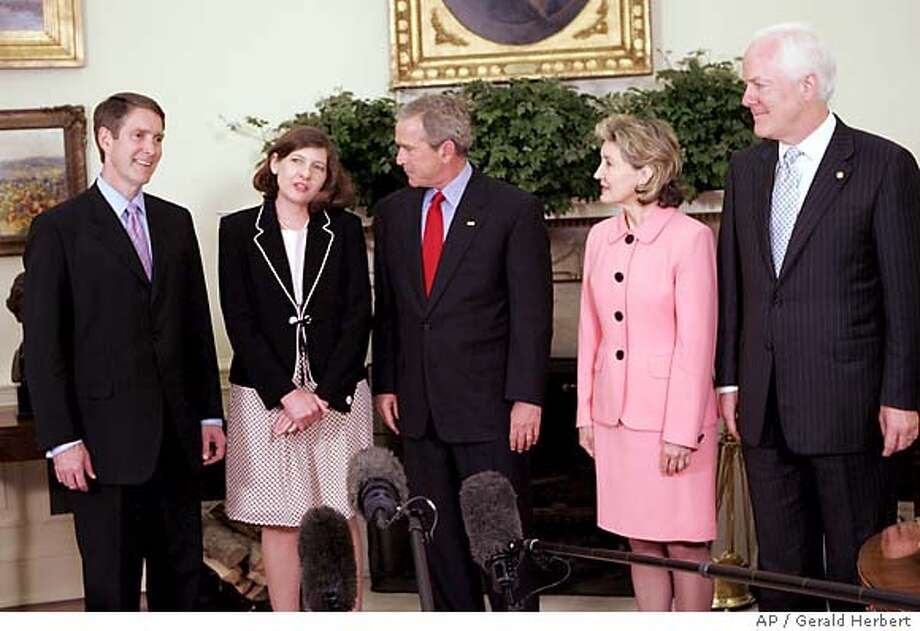 President Bush meets in the Oval Office of the White House in Washington with judicial nominee Priscilla Owen, left of Bush, Tuesday, May 24, 2005. With them are Senate Majority Leader Bill Frist, R-Tenn., left, Sens. Kay Bailey Hutchison, R-Texas, second right, and John Cornyn, R-Texas. (AP Photo/Gerald Herbert) Photo: GERALD HERBERT