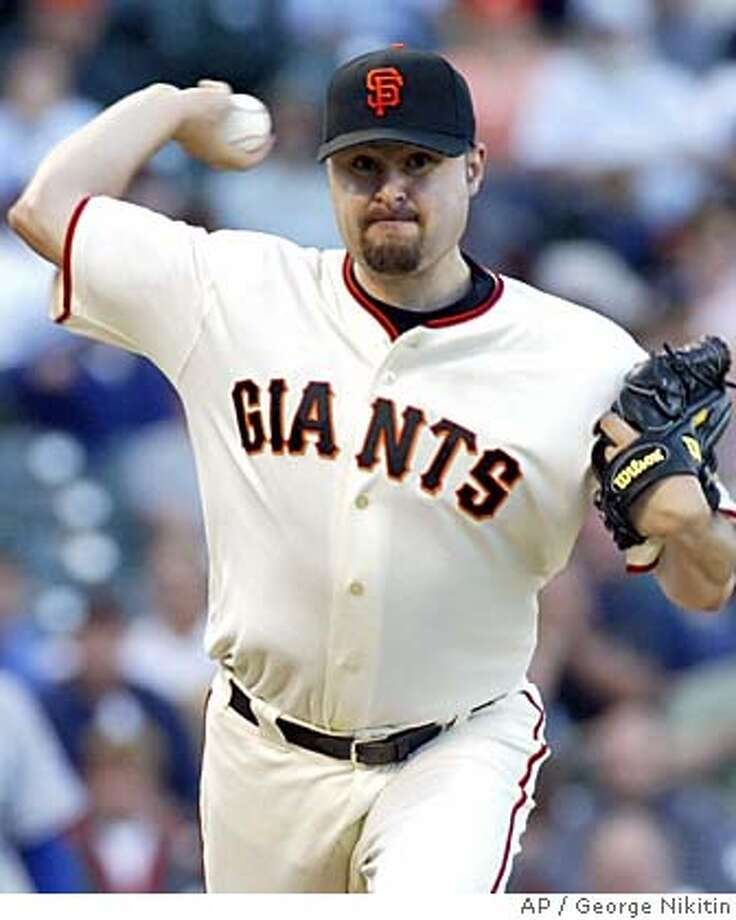 San Francisco Giants pitcher Jason Schmidt throws to first base in the first inning against the Los Angeles Dodgers, Tuesday May 24, 2005 in San Francisco. (AP Photo/George Nikitin) Photo: GEORGE NIKITIN