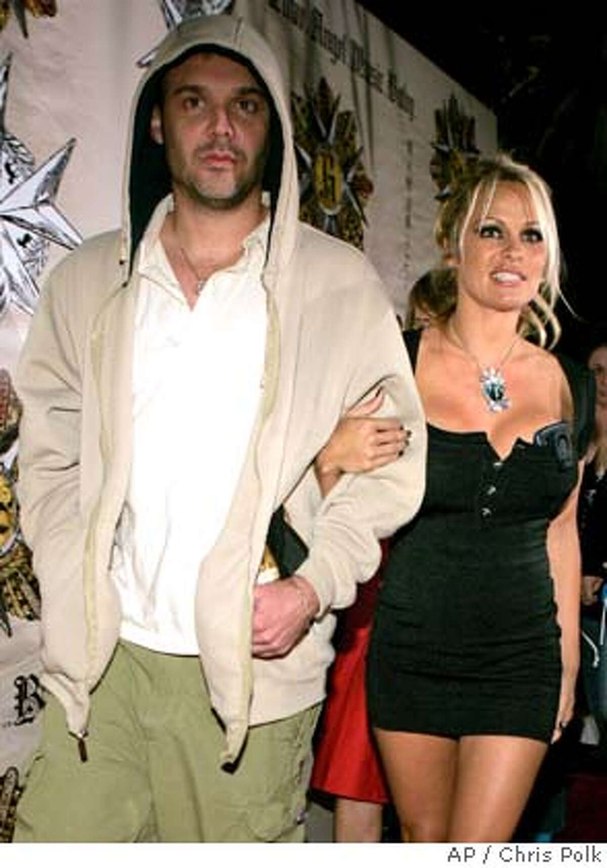 """David LaChapelle and Pamela Anderson attend a party hosted by Gwen Stefani celebrating the release of her solo album """"Love. Angel. Music. Baby"""" at the Standard Hotel in Los Angeles on Sunday Nov. 14, 2004. (AP Photo/Chris Polk)"""