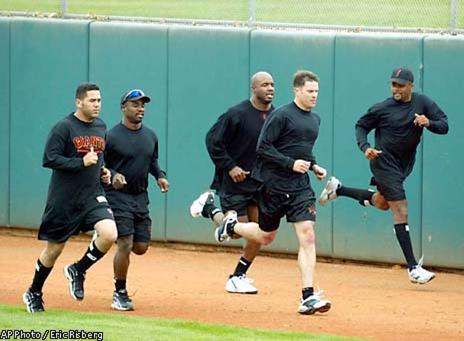 From left, San Francisco Giants' third baseman Edgardo Alfonzo, second baseman Ray Durham, left fielder Barry Bonds, first baseman J.T. Snow, and infielder Neifi Perez, run in the outfield during spring training in Scottsdale, Ariz., Thursday Feb. 20, 2003. Alfonzo, Durham, and Perez are new to the Giants this year.(AP Photo/Eric Risberg) Photo: ERIC RISBERG