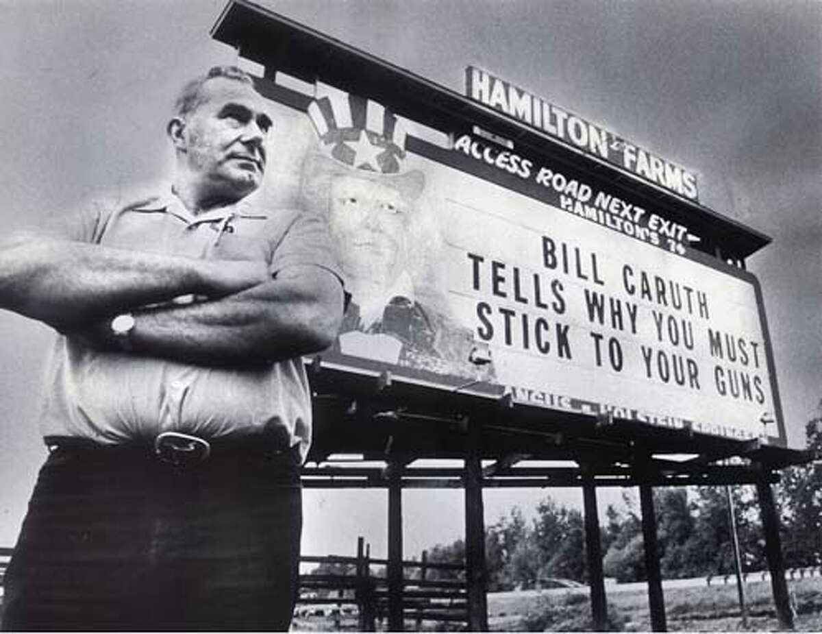 Alfred Hamilton, of Curtis, Wash., stands in front of his billboard along Interstate 5 near Chehalis in this 1978 file photo. Hamilton's conservative messages survived a Washington Supreme Court ruling banning billboards along Washington highways. Hamilton died Tuesday at age 84. Story is slugged, obit Hamilton.