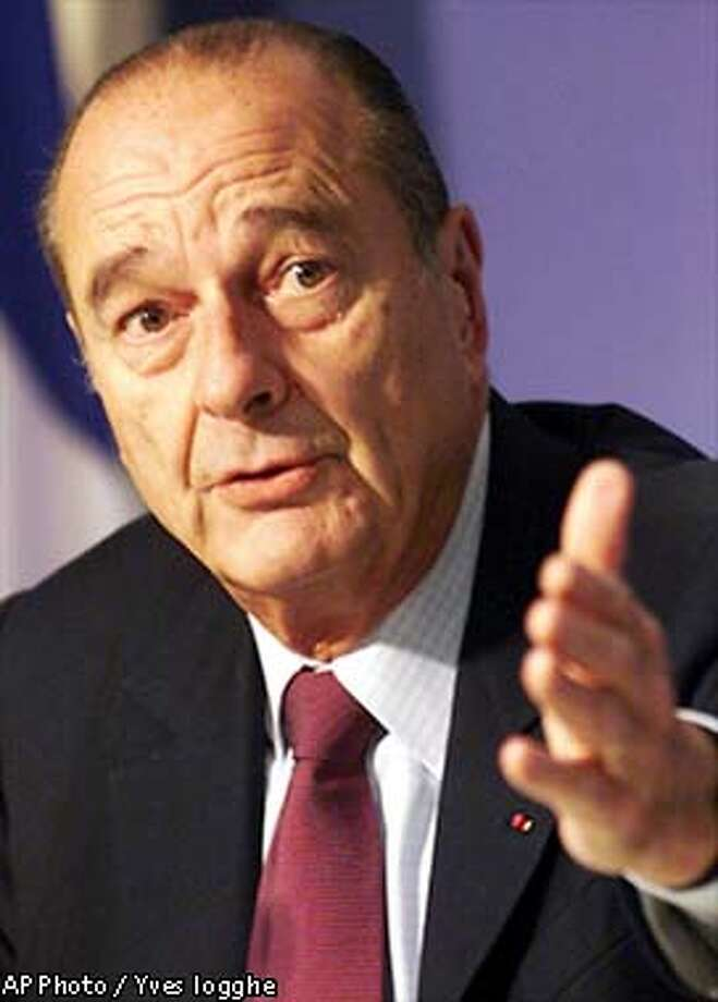 France's President Jacques Chirac addresses the media at the end of an EU emergency summit at the EU Council headquarters in Brussels, Monday Feb.17, 2003.(AP Photo / Yves logghe) Photo: YVES LOGGHE