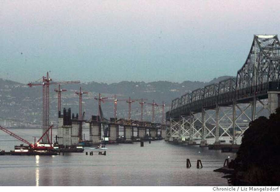 bridge008_lm  Event on 11/22/04 in Yerba Buena island.  The eastern span of the Bay Bridge, with the cranes where the new span is being constructed. This photo is from Yerba Buena Island.  Liz Mangelsdorf / The Chronicle MANDATORY CREDIT FOR PHOTOG AND SF CHRONICLE/ -MAGS OUT Metro#Metro#Chronicle#11/28/2004#ALL#5star##0422481229 Photo: Liz Mangelsdorf