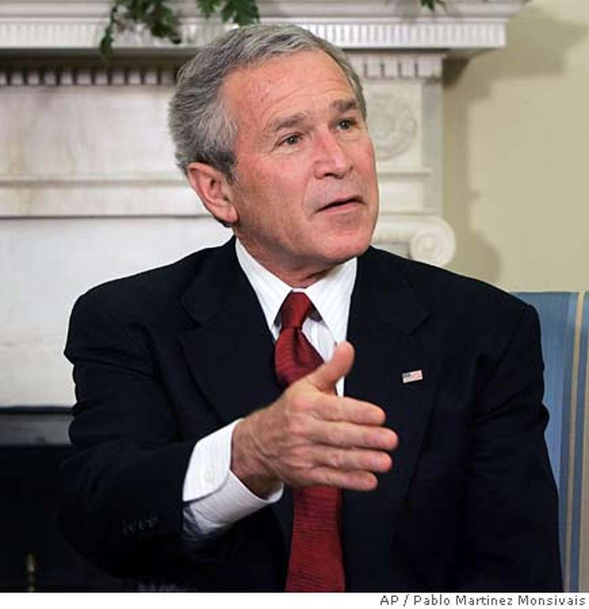 """President Bush gestures as he answers question during his meeting with the Prime Minister of Denmark in the Oval Office of the White House, Friday, May 20, 2005 in Washington. Bush said that he did not think photos of imprisoned Saddam Hussein clad only in his underwear would incite further anti-American sentiment in Iraq. """"I don't think a photo inspires murderers."""" (AP Photo/Pablo Martinez Monsivais)"""