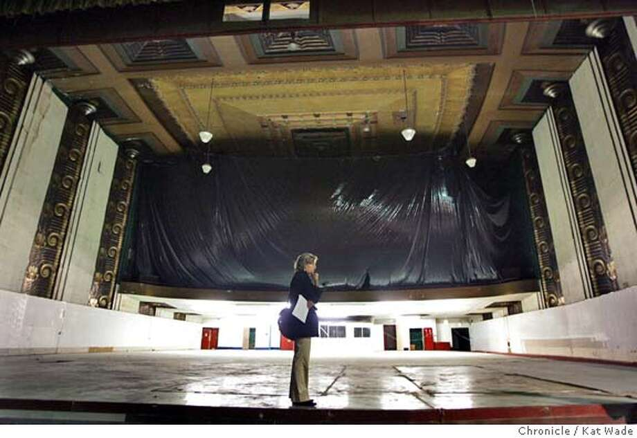 THEATER19_0050_KW.jpg  On 5/18/05 in the Alameda Jennifer Ott, the developement manager for the city of Alameda gives the San Francisco Chronicle a tour of the historic Alameda Theater by Architect Timothy L. Pflueger which the Alameda City Counsil voted Tuesday night to condemn and by through emminent domain against the will of owner John Cocores of Oakland, who does not want to sell the building. Other tenanats that occupy the block long property will need to be relocated. Kat Wade/ The Chronicle MANDATORY CREDIT FOR PHOTOG AND SF CHRONICLE/ -MAGS OUT Photo: Kat Wade