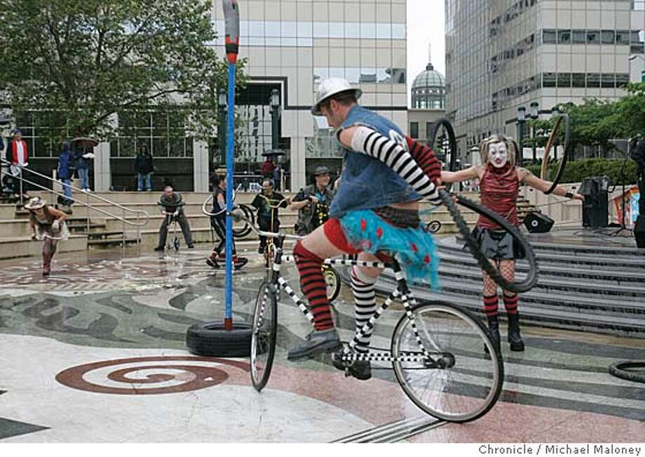 """BIKE_025_MJM.jpg  As part of Bike to Work Day, the street theater group calling themselves 'Cyclecide' entertained a small group of onlookers at Ogawa Plaza in front of Oakland City Hall with what they called a """"Bike Rodeo"""". They also brought with them a number of non-traditional bikes for the public to ride on.  Photo by Michael Maloney / San Francisco Chronicle MANDATORY CREDIT FOR PHOTOG AND SF CHRONICLE/ -MAGS OUT Photo: Michael Maloney"""