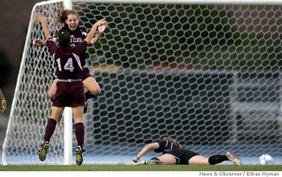 Santa Clara's Megan Kakadelas celebrates with Bree Horvath (14) after scoring Santa Clara's winning goal in overtime to beat North Carolina 1-0 in the third round of the NCAA Women's College Cup, Saturday, Nov. 20, 2004, in Chapel Hill. North Carolina goalie Aly Winget is at right. (AP Photo/News & Observer, Ethan Hyman) Photo: ETHAN HYMAN