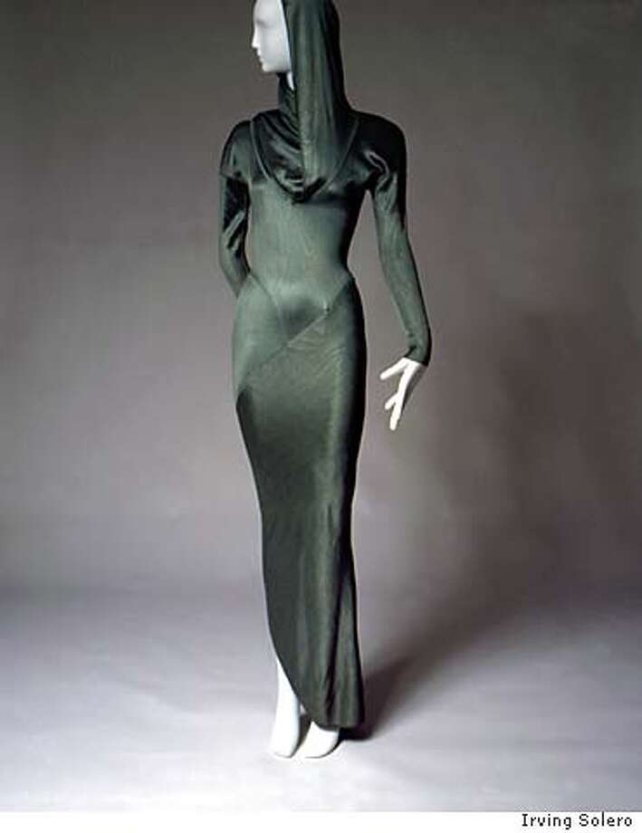 "Azzedine Alaia ""mermaid'' evening dress in green acetate knit with hood, spiral zipper set in curved seam and fishtail hem from the Winter 1986 collection. Permanent collection, Museum of Fashion Institute of Technology., New York. Photograph by Irving Solero."
