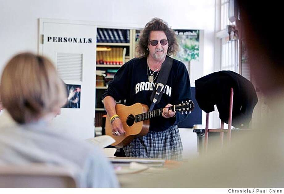 """Buzzy Martin leads a group sing along of """"My Girl."""" Buzzy Martin and his """"Music for Kids At Risk"""" program where he teaches music to teens who are in Sonoma Co. Juvenile Hall on 4/27/05 in Santa Rosa, Calif.. Martin, a professional musician for 30 years, brings hands-on teaching with guitars, drums and keyboards and has been doing this once a week for 10 years.  PAUL CHINN/The Chronicle Photo: PAUL CHINN"""